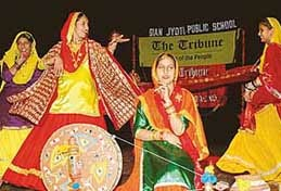 Girls perform a Folk Dance